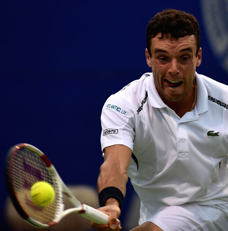 Spanish tennis player Roberto Bautista Agut in action against Chinese player Lu Yen-hsun during the quarter-final match of ATP Chennai Open 2015 in Chennai on Jan 9, 2015.