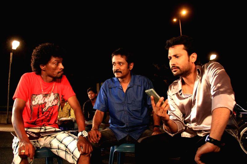 Stills from Tamil film `Ivanukku Thanila Gandam`.