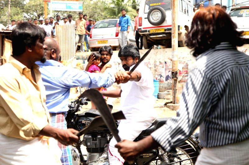 Stills from upcoming Tamil film `Vanmam`.