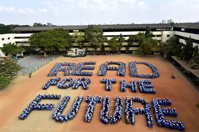 "Students make a formation in the shape of ""READ FOR FUTURE"" at a private school in Chennai on Jan. 31, 2015."