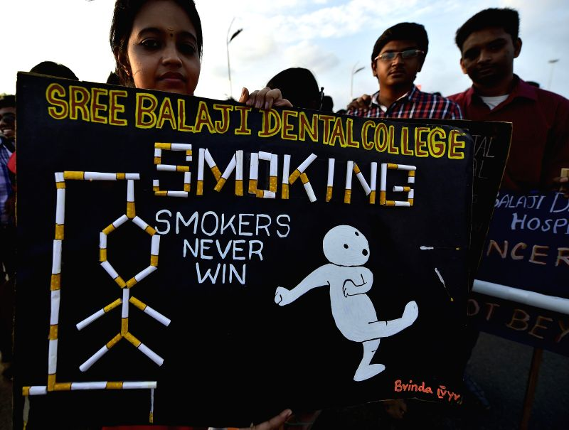 Students participate in an awareness campaign to mark the `World Cancer Day` in Chennai on Feb. 4, 2015.