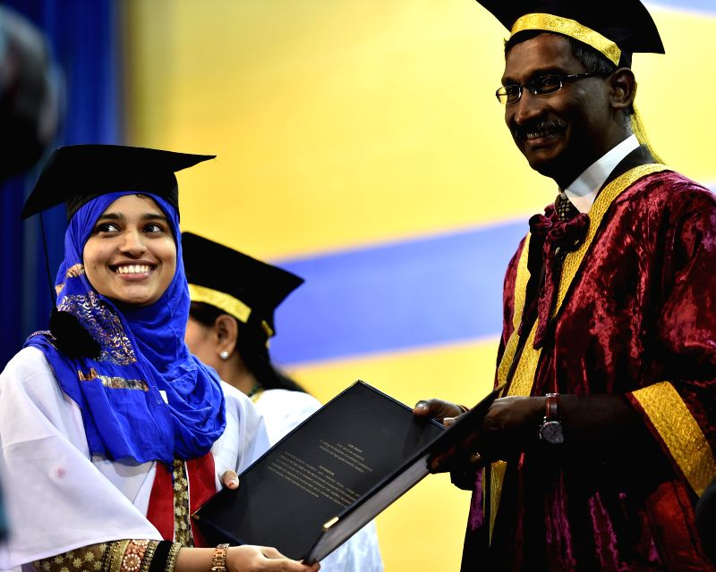 Students receives her certificate at the 8th Annual Convocation of the Saveetha University in Chennai on March 18, 2015.