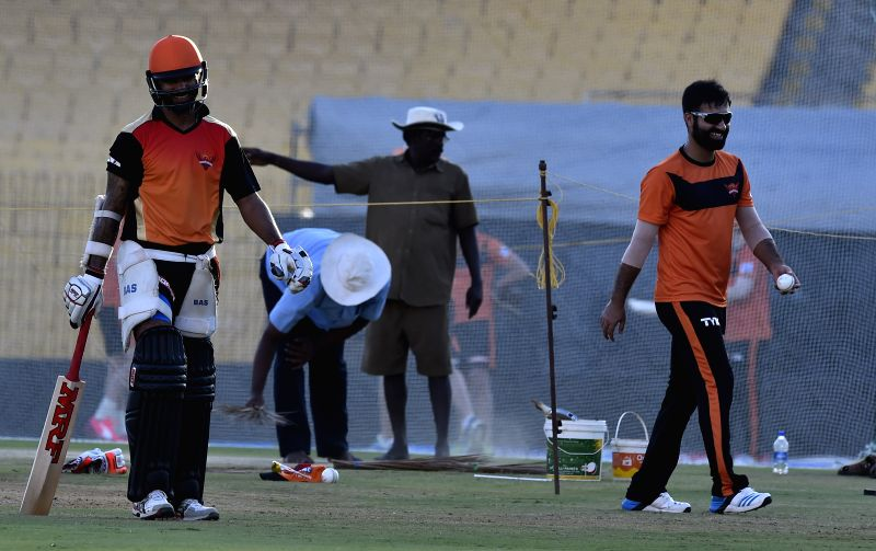 Sunrisers Hyderabad (SRH) players Shikhar Dhawan and Parvez Rasool during a practice session at the M. A. Chidambaram Stadium in Chennai, on April 10, 2015. - Shikhar Dhawan
