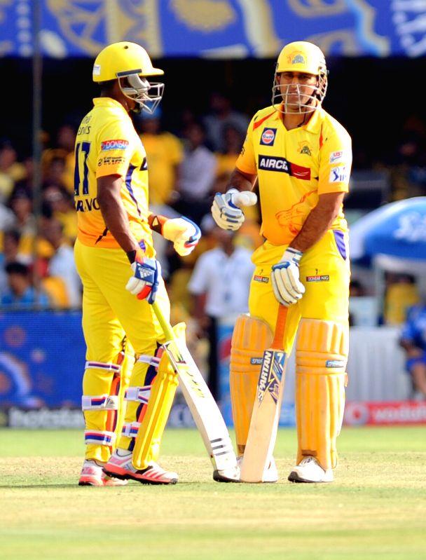 Chennai Super Kings batsmen MS Dhoni and Dwayne Bravo in action during an IPL-2015 match between Chennai Super Kings and Rajasthan Royals at Sardar Patel Stadium, Motera, in Ahmedabad, on April 19, ... - MS Dhoni and Sardar Patel Stadium