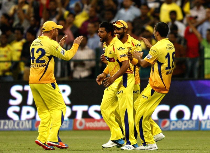 Chennai Super Kings celebrate fall of a wicket during the eighth match of IPL 2014 between Chennai Super Kings and Delhi Daredevils, played at Sheikh Zayed Stadium in Abu Dhabi of United Arab ...