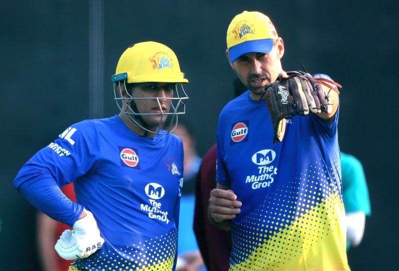Chennai Super Kings head coach Stephen Fleming and skipper MS Dhoni during a practice session in Mohali on April 14, 2018. - MS Dhoni