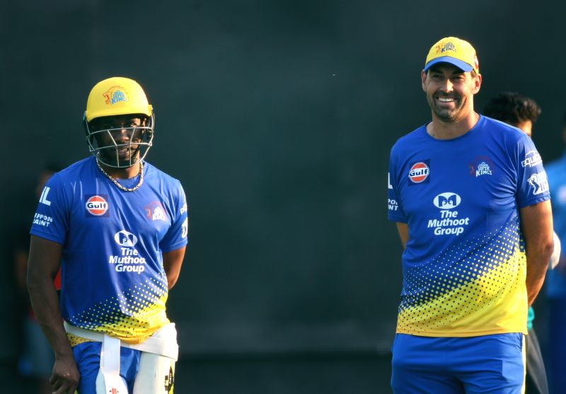 Chennai Super Kings head coach Stephen Fleming and Dwayne Bravo during a practice session in Mohali on April 14, 2018.
