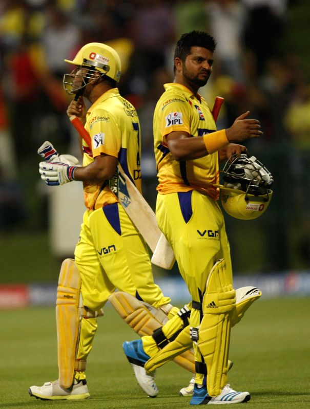 Chennai Super Kings player  M S Dhoni and Suresh Raina in action during the eighth match of IPL 2014 between Chennai Super Kings and Delhi Daredevils, played at Sheikh Zayed Stadium in Abu Dhabi of ..