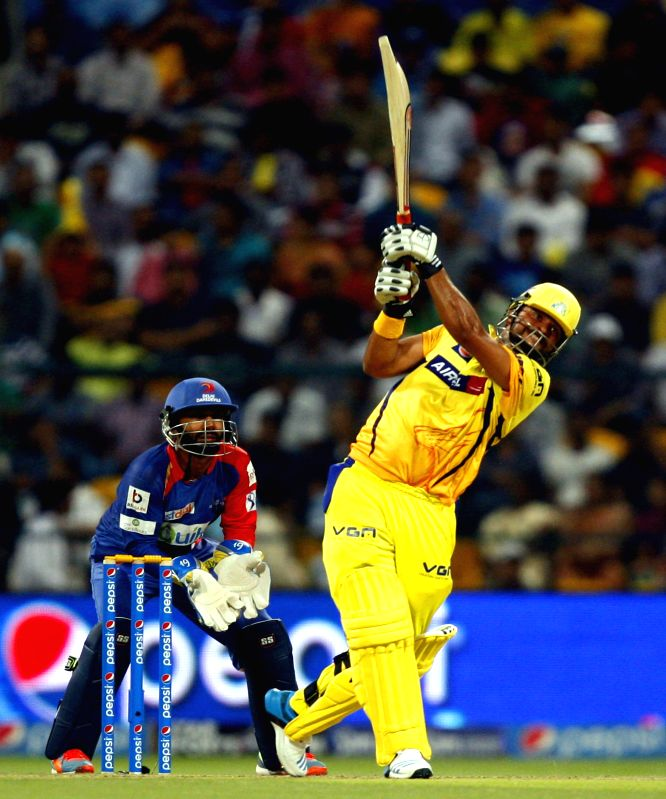 Chennai Super Kings player Suresh Raina in action during the eighth match of IPL 2014 between Chennai Super Kings and Delhi Daredevils, played at Sheikh Zayed Stadium in Abu Dhabi of United Arab ...