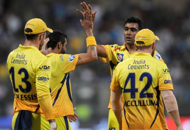 Chennai Super Kings players Brendon McCullum, Faf du Plessis, Ravindra Jadeja and Ravichandran Ashwin celebrate fall of a wicket during the 33rd match of IPL 2014 between Chennai Super Kings and ... - Ravindra Jadeja