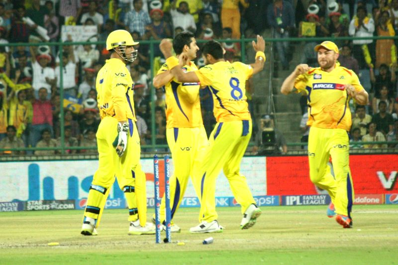 Chennai Super Kings players celebrate fall of Kevin Pietersen's wicket during the 26th match of IPL 2014 between Delhi Daredevils and Chennai Super Kings at  Feroz Shah Kotla Stadium in New Delhi on .