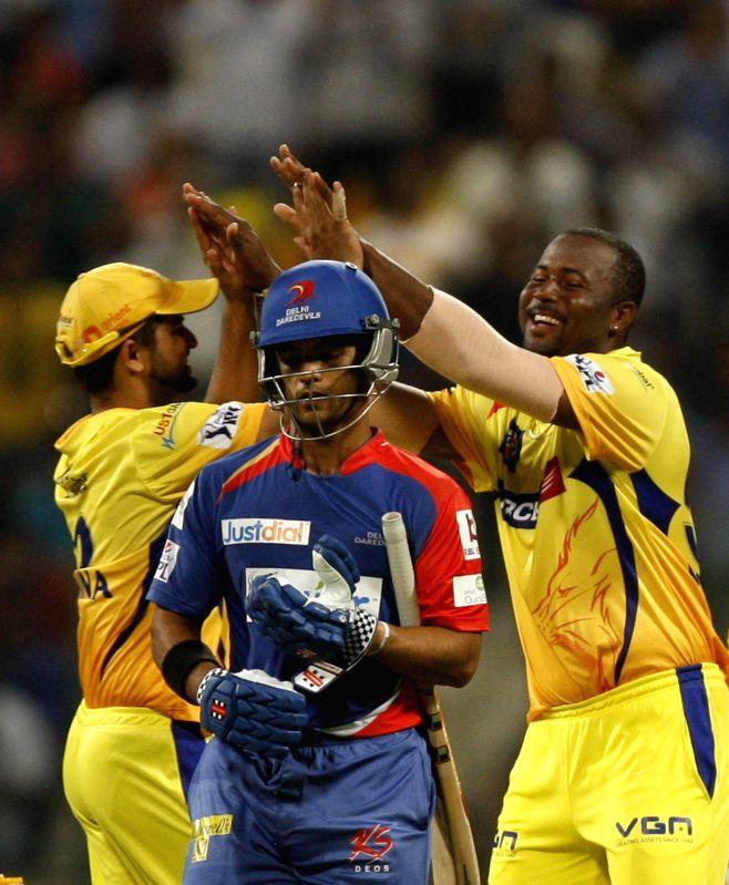 Chennai Super Kings players Dwayne Smith and Suresh Raina celebrate as  Delhi Daredevils batsman Jean-Paul Duminy walks back to the pavilion during the eighth match of IPL 2014 between Chennai Super . - Jean-Paul Duminy