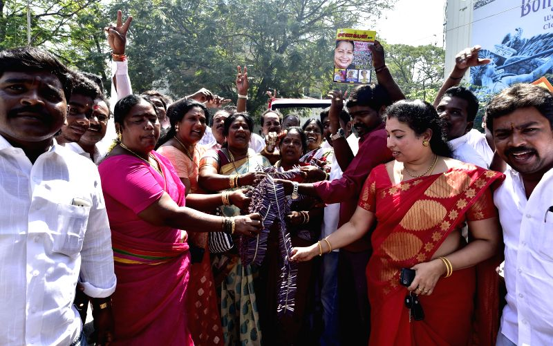 Supporters of AIADMK celebrates party candidate S Valarmathi victory in Srirangam by-poll at Poes Garden in Chennai on Feb 16, 2015.