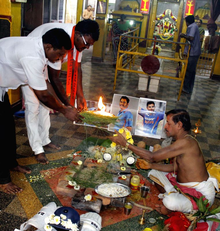 Supporters of Hindu Makkal Katchi perform pooja to pray for India`s win in the upcoming World Cup 2015 in Chennai on Feb 12, 2015.