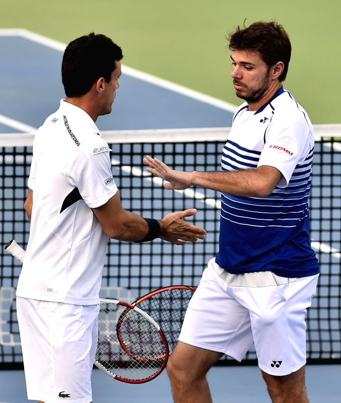 Swiss player Stan Wawrinka and Spanish player Roberto Bautista Agut during the first round of men`s doubles match at ATP Chennai Open 2015 against USA player Nicholas Monroe and Swedish ...