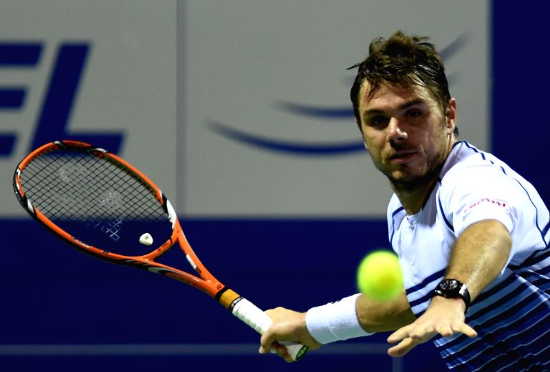 Swiss tennis player Stanislas Wawrinka in action against Belgian tennis player David Goffin during the semi-final match of ATP Chennai Open 2015 in Chennai on Jan 10, 2015.