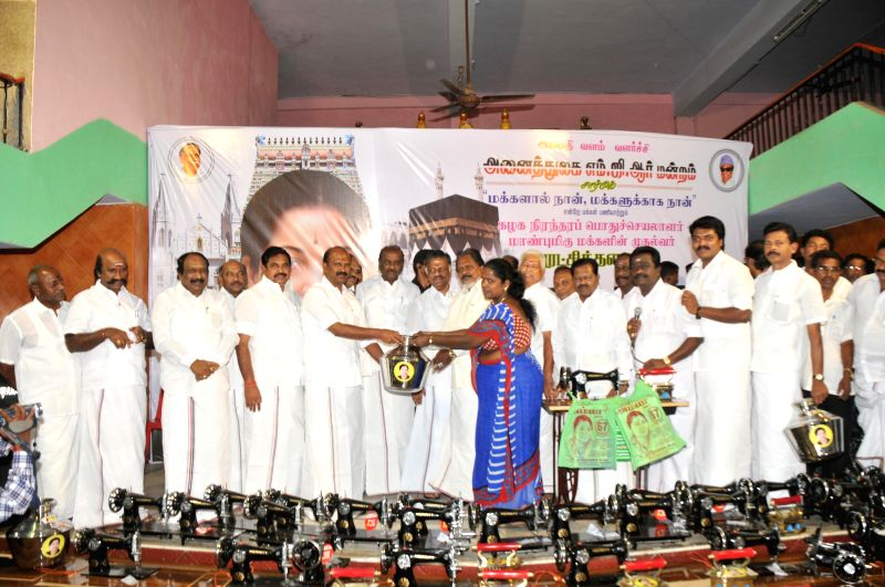 Tamil Nadu Chief Minister O Panneerselvam with AIADMK leaders during the 67th birthday of party chief Jayalalithaa on at party headquarters in Chennai on Feb 24, 2015. - O Panneerselvam