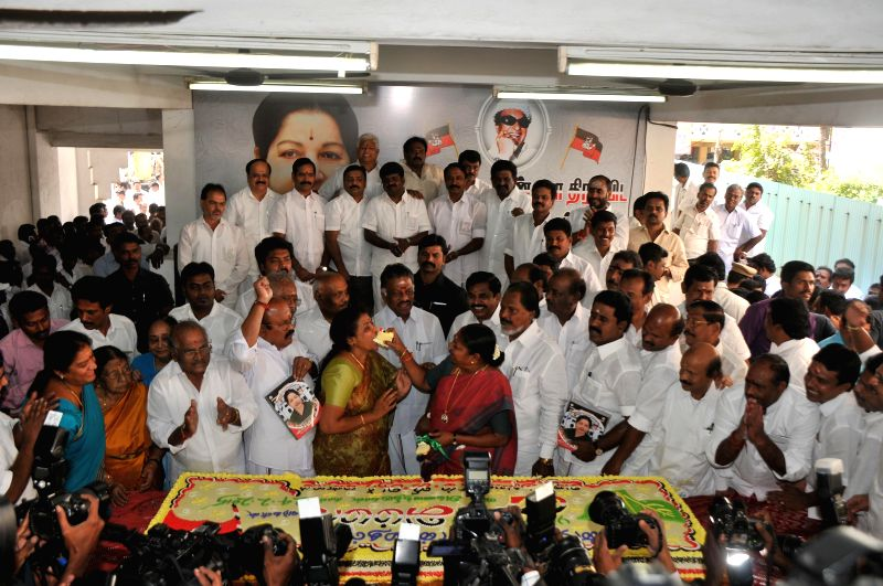 Tamil Nadu Chief Minister O Panneerselvam with AIADMK leaders during party supremo Jayalalithaa`s 67th birthday celebrations at party headquarters in Chennai on Feb 24, 2015. - O Panneerselvam