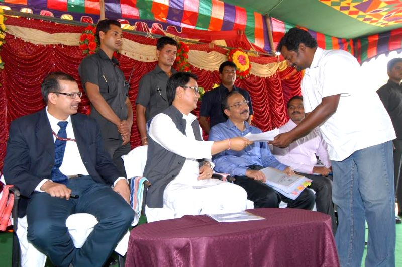 The Union Minister of State for Home Affairs Kiren Rijiju receives a representation from a Tamil refugee, at the Sri Lankan Refugee Camp, at Gummidipoondi near Chennai in Tamil Nadu on March ...