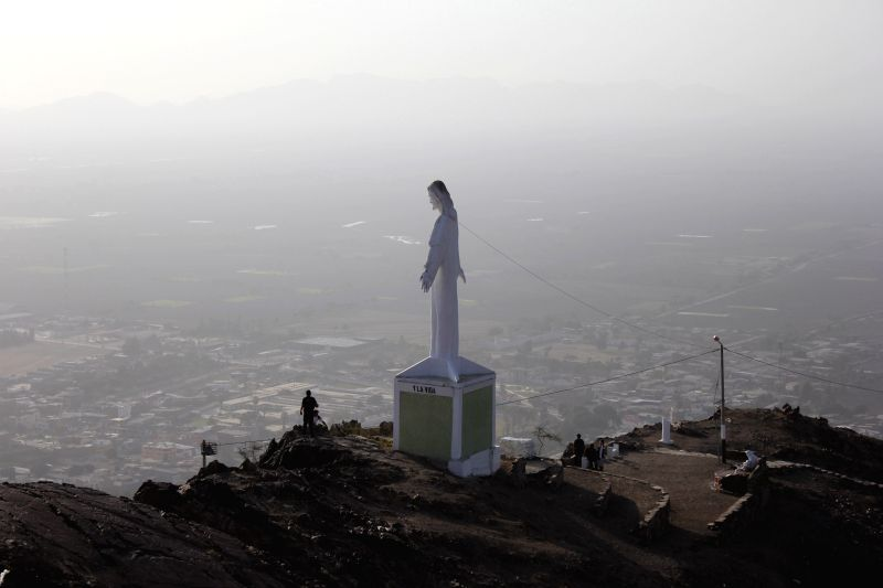 A Christ the Redeemer statue is seen at the top of the Stations of the Cross of Chepen's Mount, in the district and province of Chepen, of La Libertad department, Peru, on Nov. 22, 2014. The .