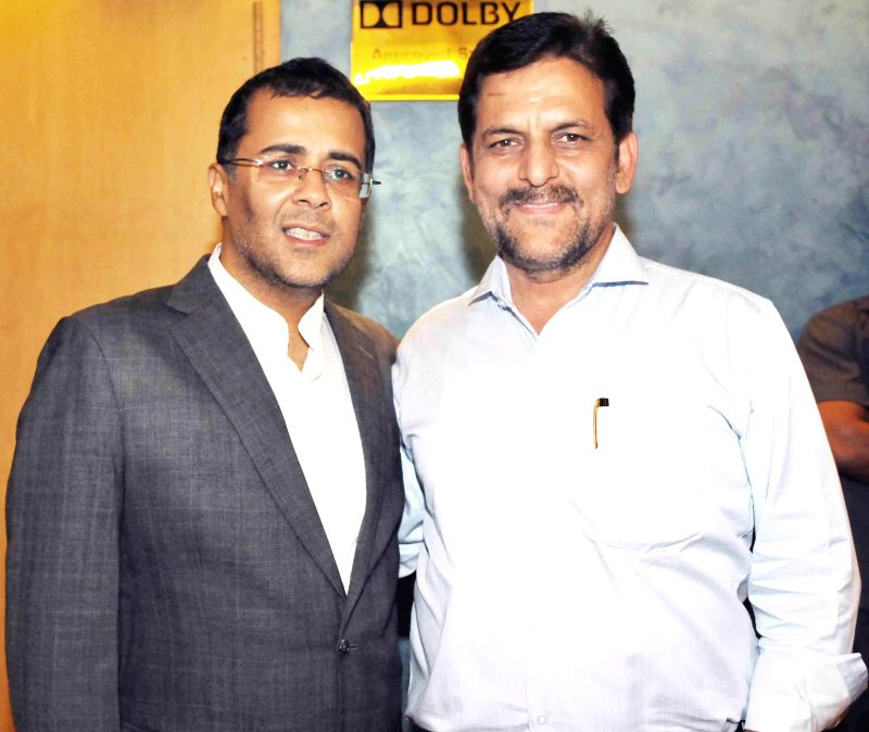 Chetan Bhagat with Rakesh Madhotra ceo nadiad wala grandson during special screening of film 2 States at YRF Studios in Mumbai on April 17, 2014.