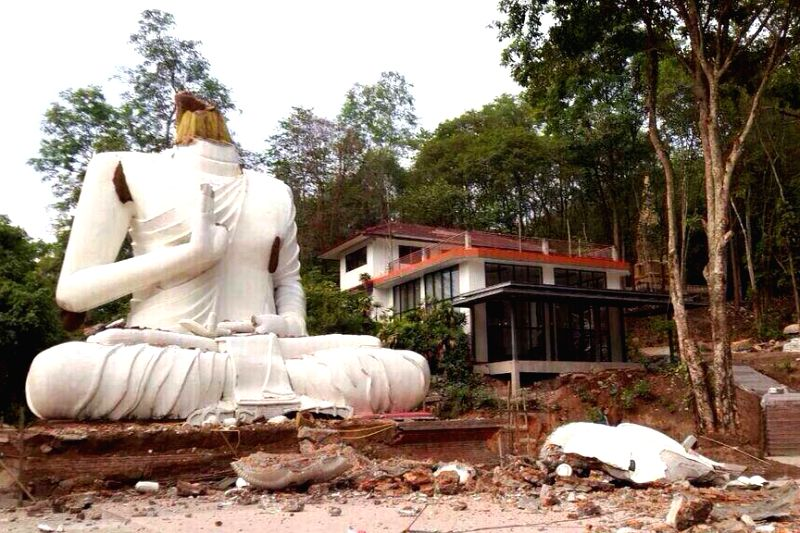 A Buddha statue is seen damaged after an earthquake in Chiang Rai, northern Thailand, May 5, 2014. A 6.1-magnitude earthquake occurring at a depth of 10 km jolted .
