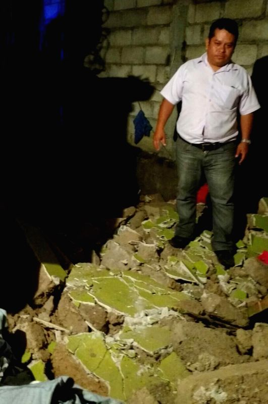 CHIAPAS, June 14, 2017 - A man inspects a damaged house in Puerto Madero, Chiapas, Mexico, on June 14, 2017. A 7.1-magnitude earthquake jolted Guatemala at 3:29 p.m. Wednesday (Beijing Time), ...