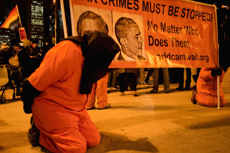 Activists are dressed up as prisoners to protest American torture in Chicago on Dec.10, 2014. Around 200 anti-violence activists held a peaceful assembly on the International Human Rights ...
