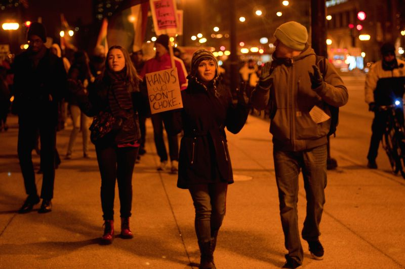 Activists hold a rally in Chicago on Dec.10, 2014. Around 200 anti-violence activists held a peaceful assembly on the International Human Rights Day in Chicago. Some of them protested ...