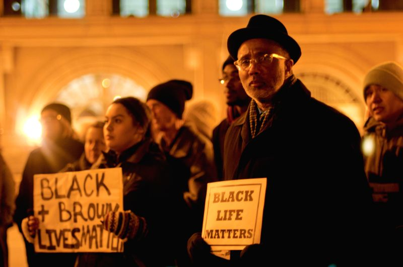 Activists hold banners in a peaceful assembly in Chicago on Dec.10, 2014. Around 200 anti-violence activists held a peaceful assembly on the International Human Rights Day in Chicago. Some ..