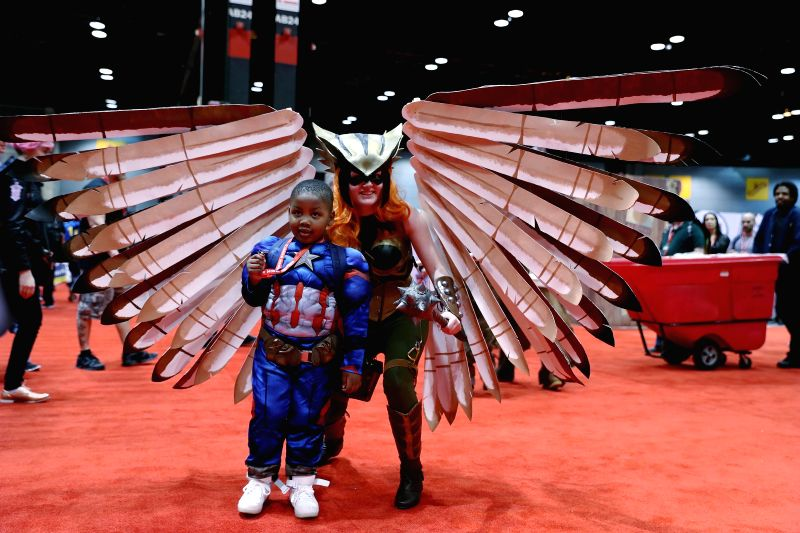 CHICAGO, April 22, 2017 - A female cosplayer dressed in costume and a boy in Captain America's costume pose for pictures during the Chicago Comic and Entertainment Expo (C2E2) in Chicago, the United ... - Americ