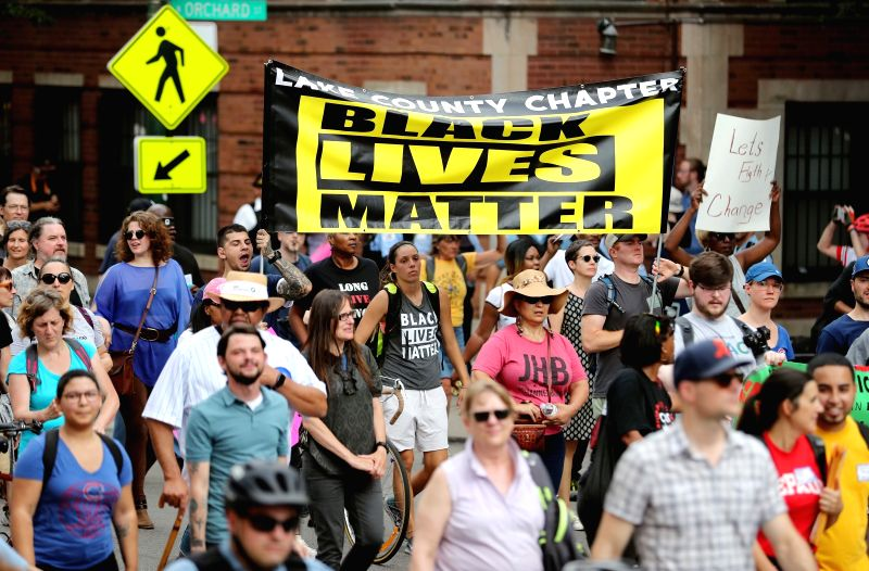 CHICAGO, Aug. 3, 2018 - Protesters participate in anti-violence march in Chicago, the United States, Aug. 2, 2018. Hundreds of protesters marched through Chicago's iconic Lake Shore Drive on Thursday ...