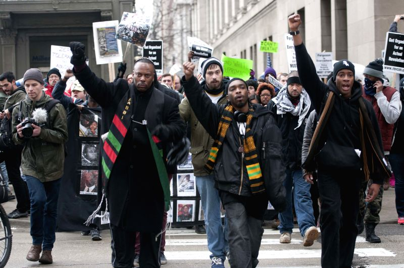 People attend a demonstration in downtown Chicago, U.S., against racism and police violence in the United States, Dec. 13, 2014.