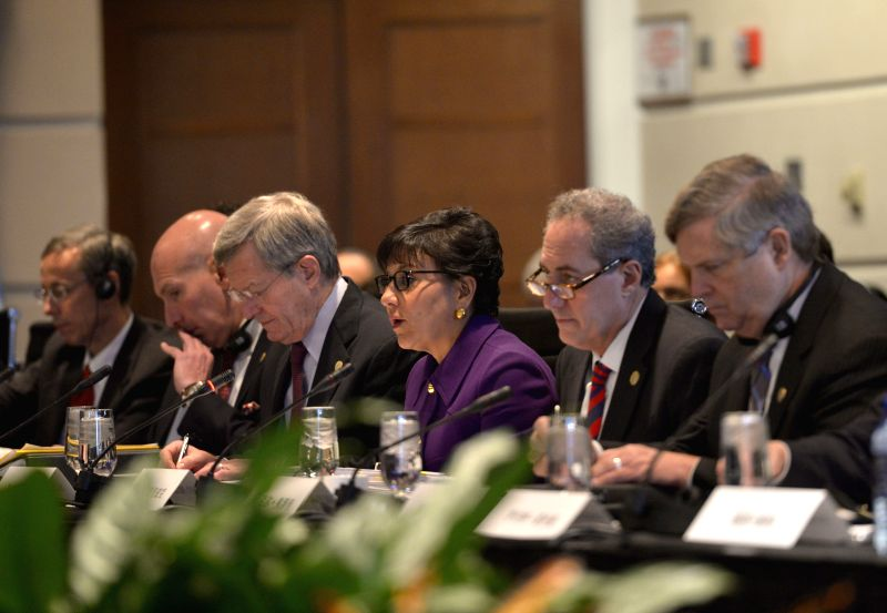 U.S. Commerce Secretary Penny Pritzker (3rd R) and U.S. Trade Representative Michael Froman (2nd R) attend the 25th Plenary Session of China-U.S. Joint Commission ..