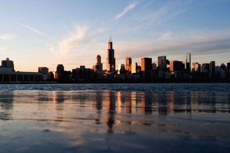 Photo taken on Dec. 30, 2014 shows the skyline of Chicago, the United States, during Sunset. Chicago, nicknamed as the windy city, is famous for its skyline and ...
