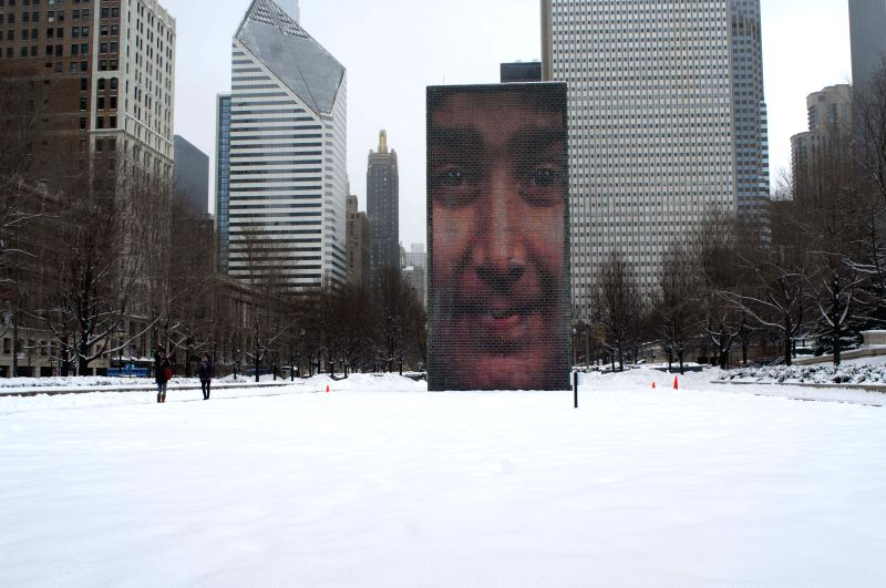The snow-covered millennium park is seen in Chicago, the United States, Feb. 26, 2015. Chicago's average temperature of this month may break the record set in 1875 ...