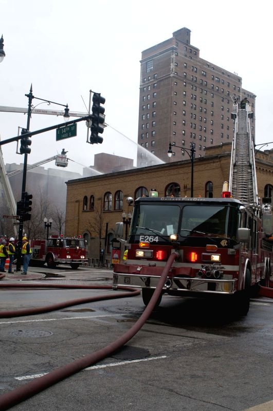 Firefighters work to extinguish a fire   broken out in a restaurant in downtown Chicago, the United State  s, on Dec.10,2014.A fire caused by propane tanks accident broke out in downtown ...