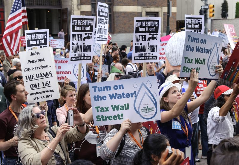 Demonstrators line up outside Cobo Center in Detroit, the United States, on July 18, 2014, as they prepare to take to the streets in protest of residential water ...