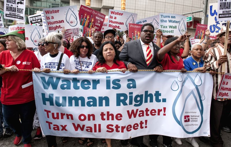Members of National Nurses United, Michigan Welfare Rights Organization, The People's Water Board and other local community groups, clergy and supporters take to ...
