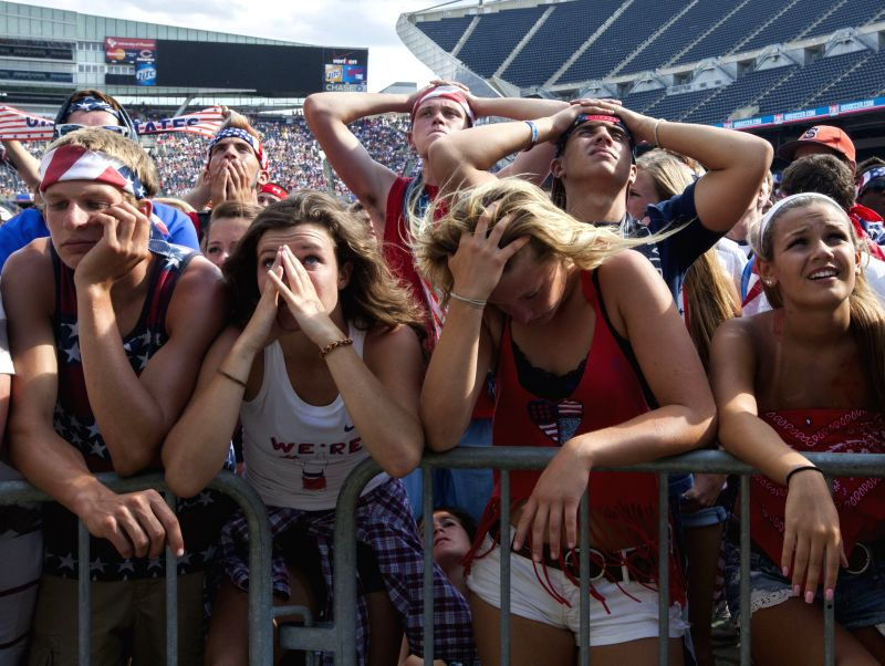 Fans are disappointed while watch the televised 2014 World Cup match against Belgium at Soldier's Field in Chicago, the United States, on July 1, 2014.