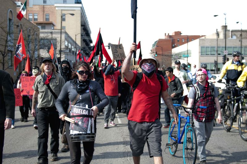 Demonstrators participate in a May Day march in Chicago, the United States, on May 1, 2015. This year the march not only focuses on labor issues but also on police ...