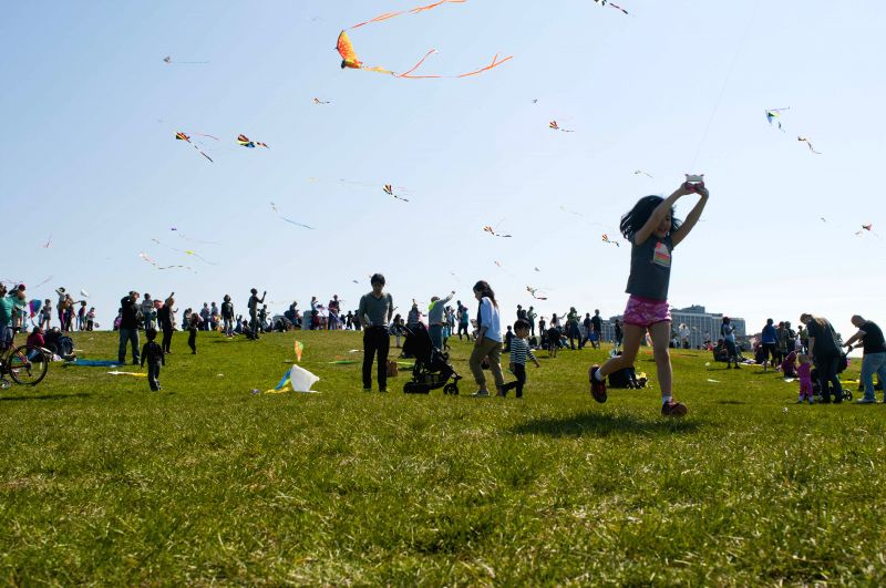 Kids and their parents fly kites on Cricket Hill in Chicago, the United States on May 2,2015. The annual Kids and Kites festival, organized by the Department of ...
