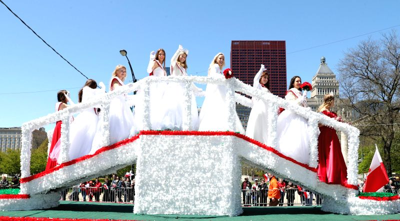 CHICAGO, May 7, 2017 - Young women from Polish Community participate in Polish Constitution Day Parade at Columbus Drive in Chicago, the United States, on May 6, 2017.