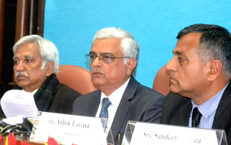 Chief Election Commissioner (CEC) Om Prakash Rawat with Election Commissioners Sunil Arora and Ashok Lavasa during a press conference on District wise review on poll-preparedness for ... - Commissioners Sunil Arora