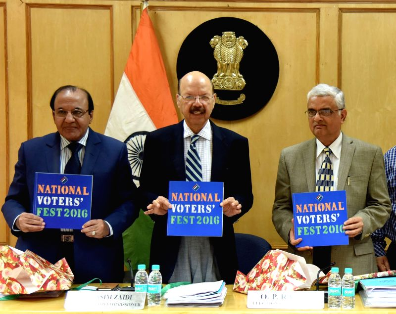Chief Election Commissioner, Dr. Nasim Zaidi release the document on National Voter's Fest 2016 during a programme, in New Delhi on July 18, 2016. Also seen the Election Commissioners AK ...