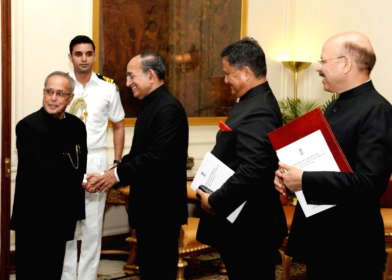 Chief Election Commissioner V S Sampath, and Election Commissioners H.S. Brahma and Syed Nasim Ahmad Zaidi during a meeting with President Pranab Mukherjee  in New Delhi on May 18, 2014.