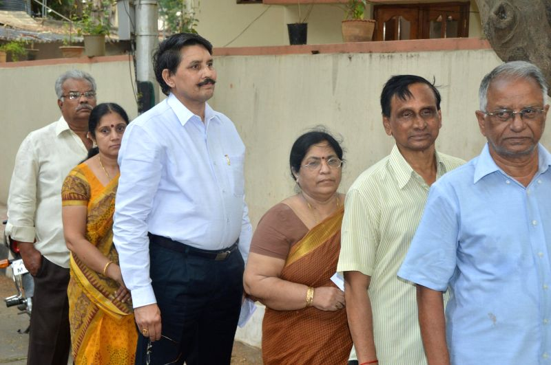 Chief Electoral Officer Bhanwar Lal stands in a queue to cast his casts his vote at a polling booth during the seventh phase of 2014 Lok Sabha Polls in Hyderabad on April 30, 2014.