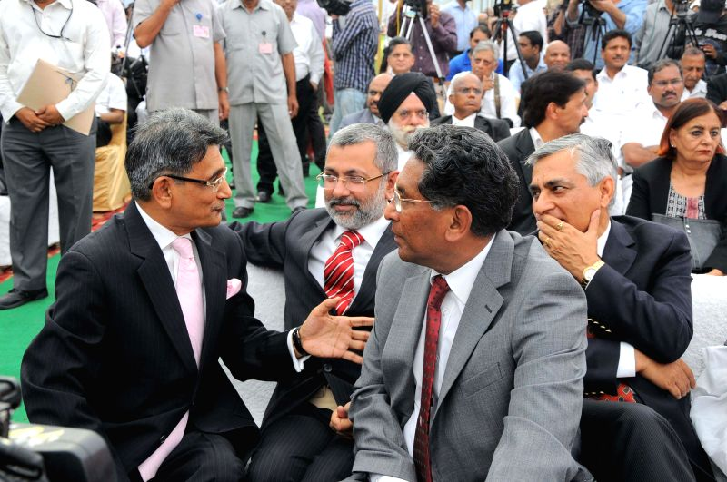 Chief Justice-designate Justice R M Lodha with out going Chief Justice of India P Sathasivam at a farewell organised by the Supreme Court Bar Association in New Delhi on April 25, 2014.