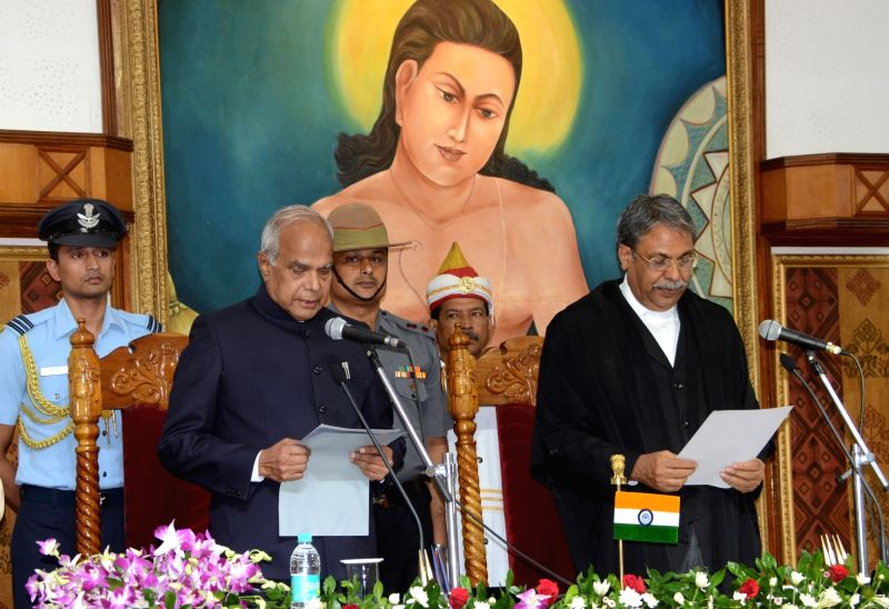 Chief Justice of Guwahati High Court, Justice Ajit Singh (R) administers the oath of office to Banwarilal Purohit as Governor of Assam during a swearing in ceremony at Raj Bhawan in ... - Ajit Singh