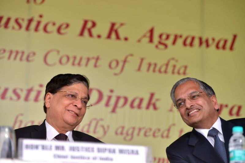 Chief Justice of India Dipak Misra and Justice RK Agrawal during the Justice RK Agrawal's farewell ceremony organised by Supreme Court Bar Association (SCBA) at Supreme Court in New Delhi ...